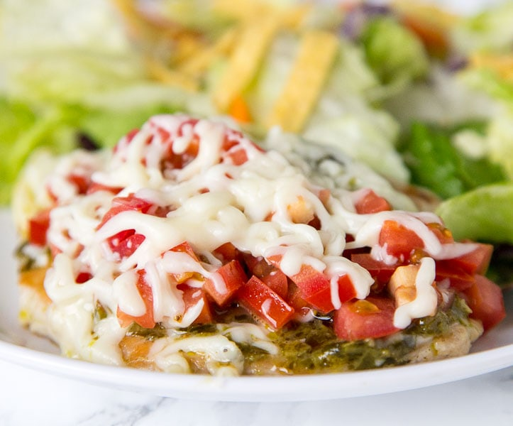 Italian Turkey Cutlets - thick pieces of turkey seared and topped with pesto, tomatoes, and melty cheese. Ready in 15 minutes, and great any night o