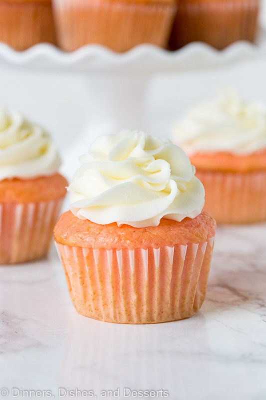 Strawberry Almond Cupcakes - doctor up box cake mix and turn them into these moist and fluffy cupcakes. Topped with almond flavored frosting!