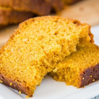 A close up of a slice of  punpkin bread on a plate