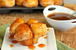Pumpkin Caramel Monkey Bread Muffins with bowl of caramel in background