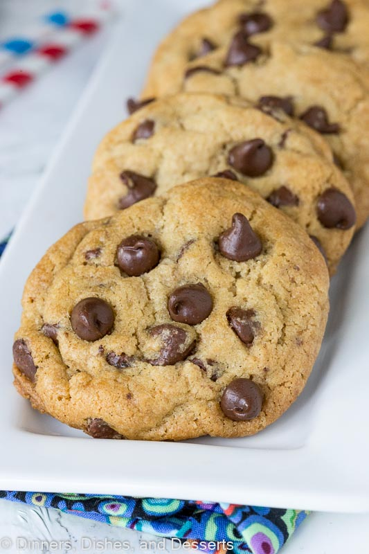 thick and chewy chocolate chip cookies lined on a plate
