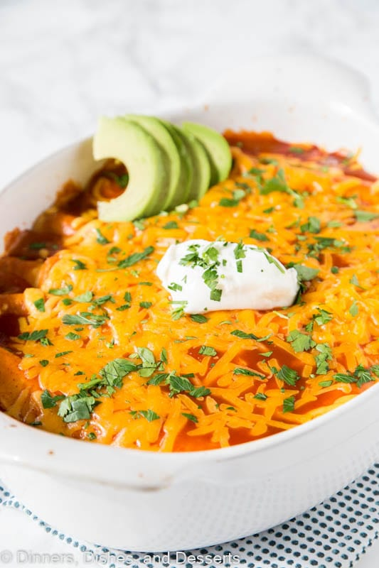 A plate of food, with Enchilada and Cream