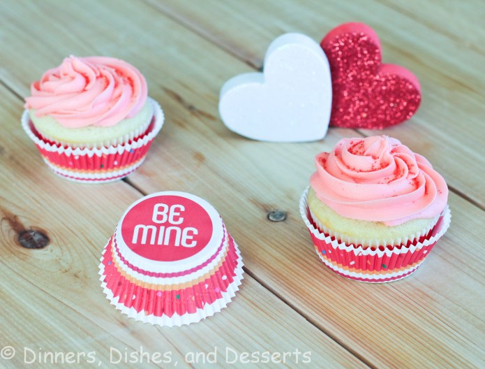 2 vanilla cupcakes with pink frosting
