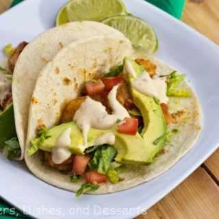 baja shrimp tacos on a plate