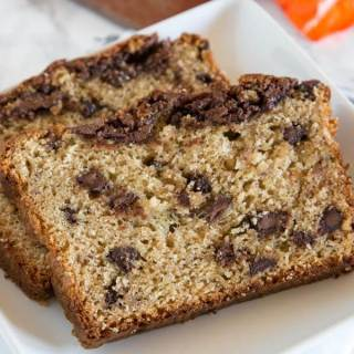 Peanut Butter Banana Bread - moist, tender banana bread made with creamy peanut butter. Full of peanut butter cups and Nutella swirl!