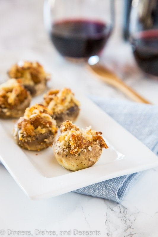Stuffed Mushrooms - A great appetizer for just about any occasion. Sausage stuffed mushrooms are full of Italian seasoning, sausage and plenty of cheese!