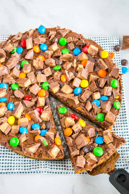 Turn cookies into pizza topped with your favorite candy.  Super easy to make and over the top dessert.
