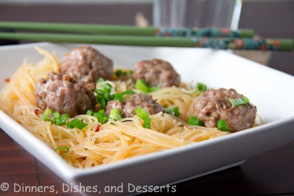 asian meatballs with spicy rice noodles on a plate