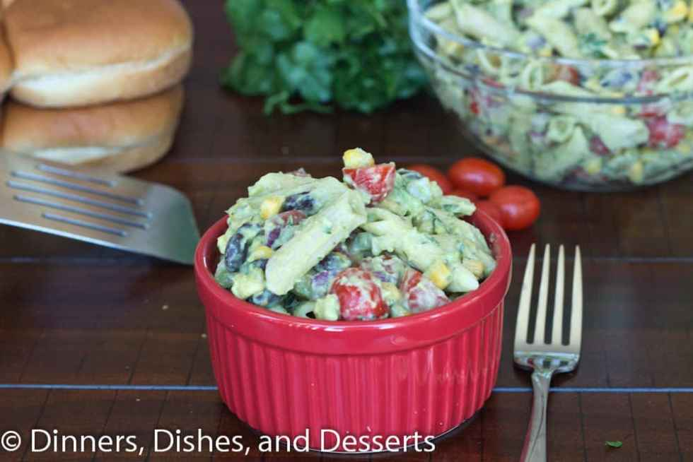 Creamy Avocado Pasta Salad - an easy pasta salad recipe for summer. Mix in corn, black beans, tomatoes and toss with a creamy avocado dressing. Great for potlucks, lunch or an easy dinner!