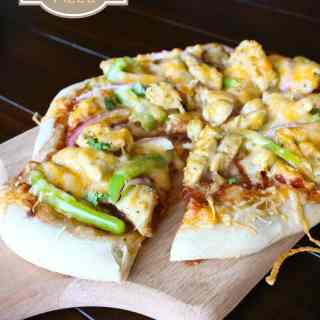 chicken fajita pizza on a board