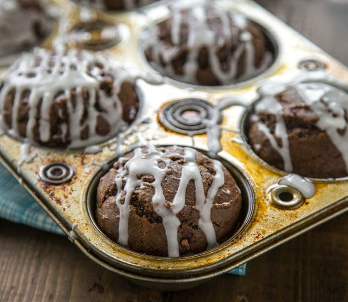 Chocolate Pumpkin Muffins with Pumpkin Spiced Glaze are a great treat to have around for breakfast, lunch box treats, or after school snacks.