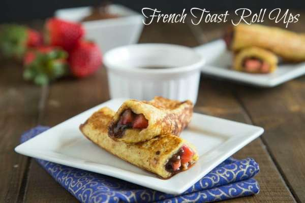 French Toast Roll Ups - Bring breakfast to a whole new level with these roll ups.  French toast filled with strawberries and chocolate hazelnut spread