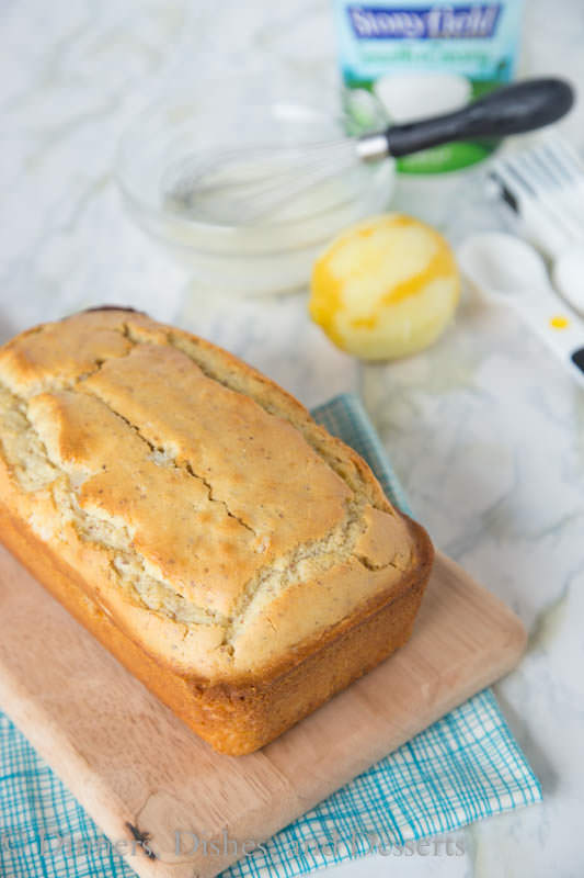 Iced Almond-Lemon Loaf Cake - super moist and tender loaf cake with lots of lemon flavor.  Topped with a tangy lemon glaze.