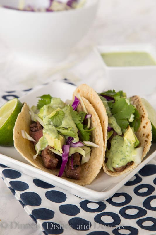 Skirt steak street tacos – tender grilled skirt steak wrapped in a charred corn tortilla and topped with a creamy cilantro lime sauce. Just like Southern California at home in no time!