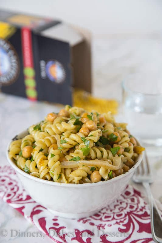 Middle Eastern Pasta Salad - put a spin on your traditional pasta salad with a chutney lime vinaigrette, chickpeas, cumin and sauteed onions. It is great served hot or cold!