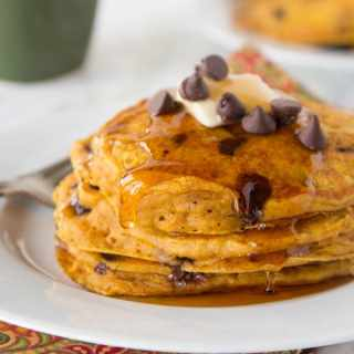 Pumpkin Chocolate Chip Pancakes - super light and fluffy pumpkin pancakes full with lots of chocolate chips and topped with maple syrup.