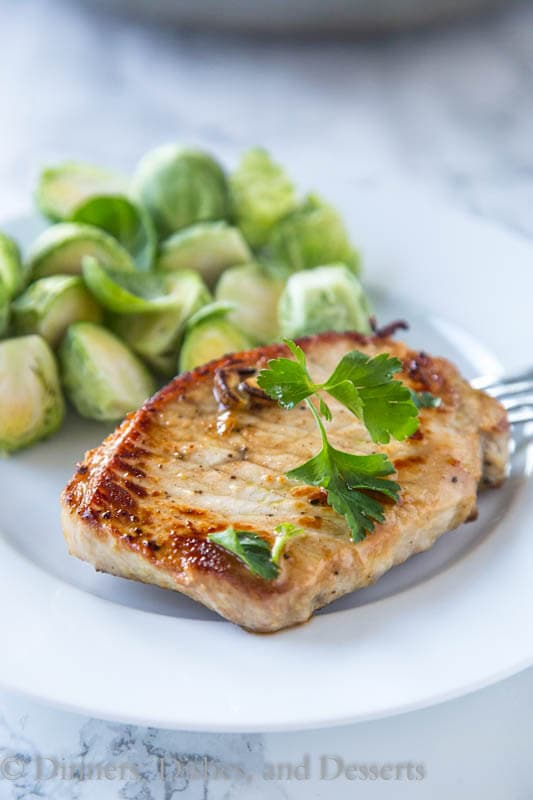 Lemon Garlic Pork Chops - Thick pork chops marinated in lemon and garlic, and then seared to perfection. Lots of flavor, and super juicy pork chops in minutes!