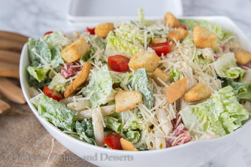 Caesar Pasta Salad - combine two favorites for one perfect summer side dish. Caesar salad and pasts salad come together in an easy dish everyone will love!