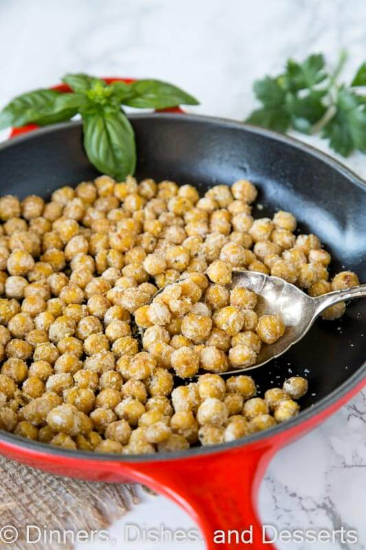 chickpeas in a skillet with basil