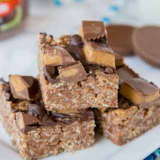Reese's Peanut Butter Rice Krispie Treats - An easy Rice Krispie treat made with Reese's peanut butter spread, topped with chocolate and peanut butter cups!