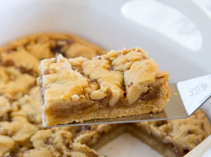 salted caramel crumble bars in a pan