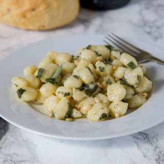 Parmesan Gnocchi with Sage Butter- comfort food that is on the table in 15 minutes. Soft gnocchi tossed with melted butter, sage, and Parmesan cheese!