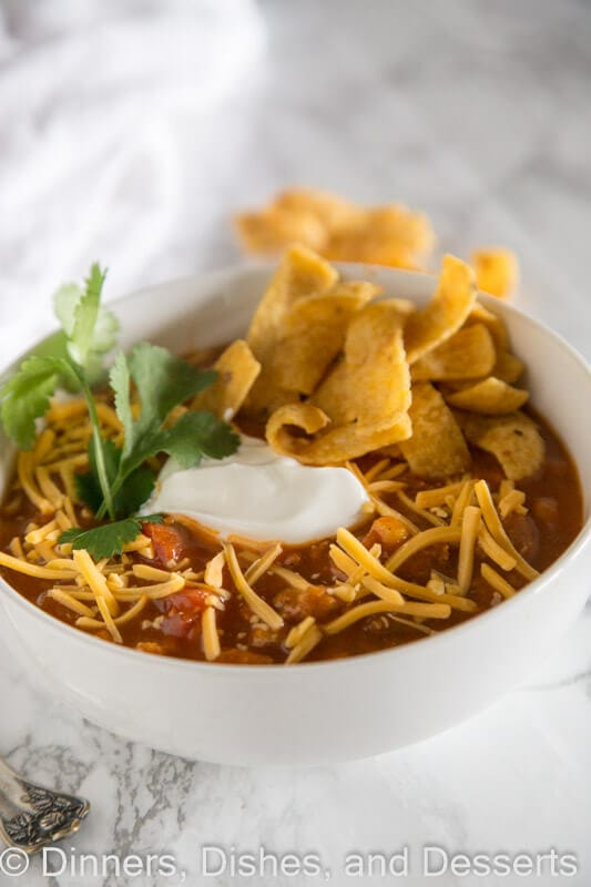 Easy Taco Soup - a hearty and comforting taco flavored soup that is ready in minutes. Top with your favorite toppings to make it even better!