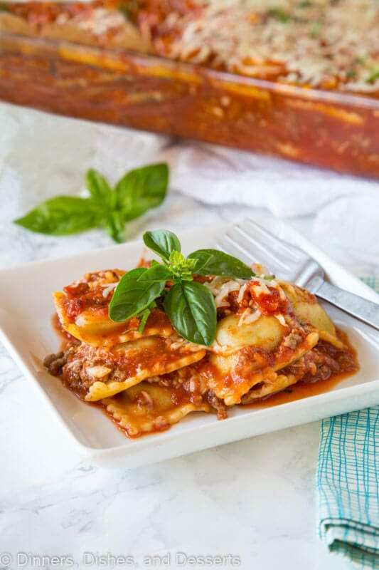 a plate of baked ravioli with basil