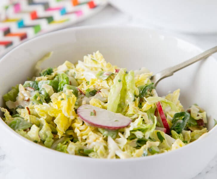 Asian Napa Cabbage Slaw - a crunchy cabbage slaw salad with lots of veggies and a creamy asian style soy dressing. Great for lunches, get togethers or with your next barbecue.