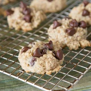 Banana Oatmeal Chocolate Chip Cookies - Tender and super moist chocolate chip cookies loaded with oats and bananas. Thick, chewy, and a fun new treat!