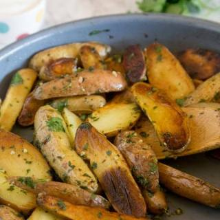 Pan Seared Mojo Potatoes - fingerling potatoes are seared and cooked to perfection in just minutes. Then mixed with a cilantro and herb mixture for a delicious side dish.
