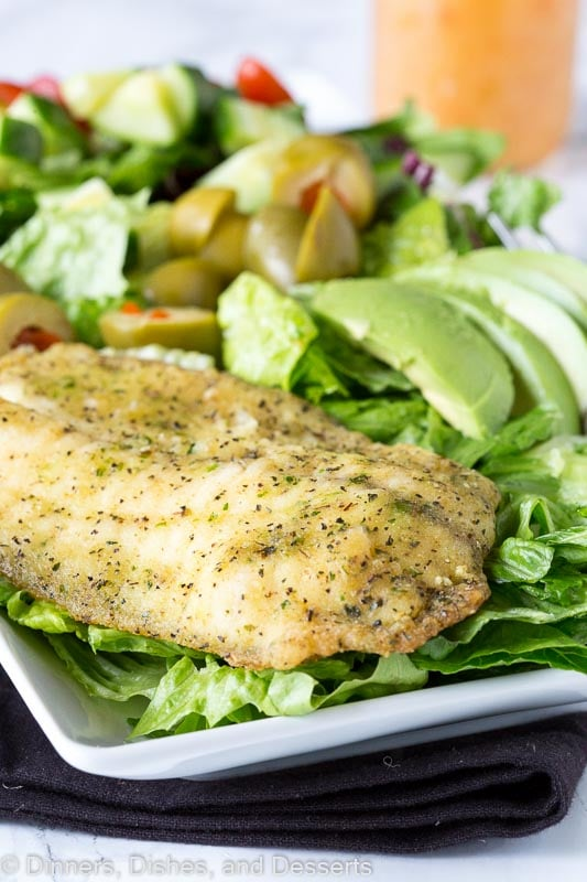 A salad with garlic herb fish with Garlic and Vinaigrette