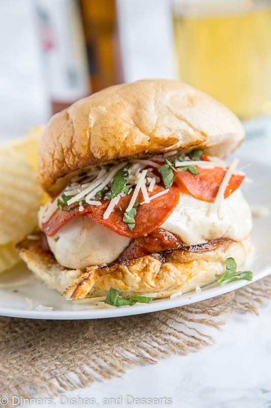 Pepperoni Pizza Burger - Combine 2 favorites with this easy burger recipe. Sausage and beef make up the burger, top with pizza sauce, cheese, and pepperoni for an epic burger night!