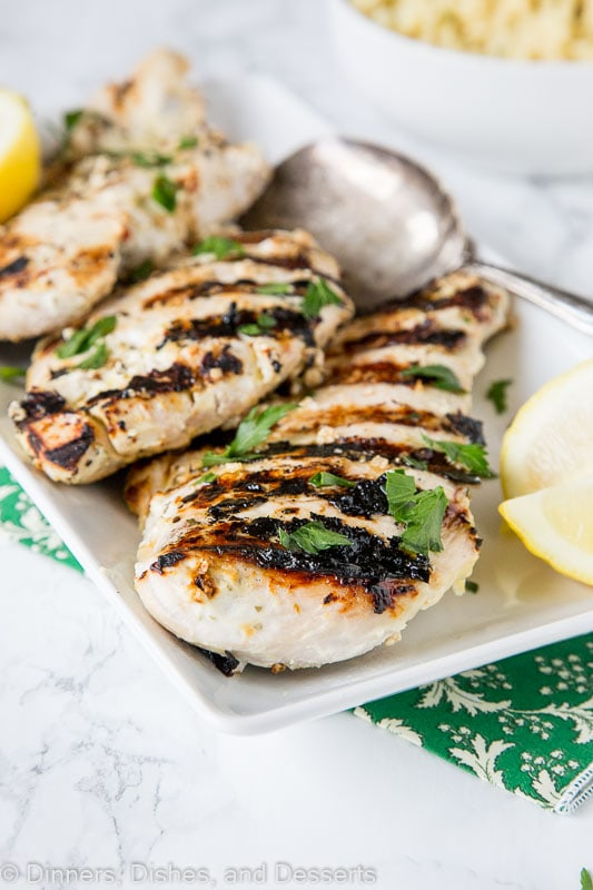 Yogurt Marinated Chicken - chicken breasts marinated in a blend of yogurt, lemon juice, and Greek seasonings. Then grilled to perfection. A quick and easy dinner all summer long.