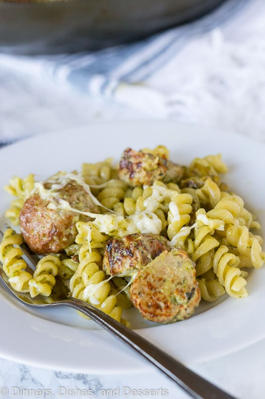 Pesto Pasta with Meatballs - a quick and easy dinner recipe with a creamy pesto sauce, pasta, a few meatballs, and plenty of cheese!