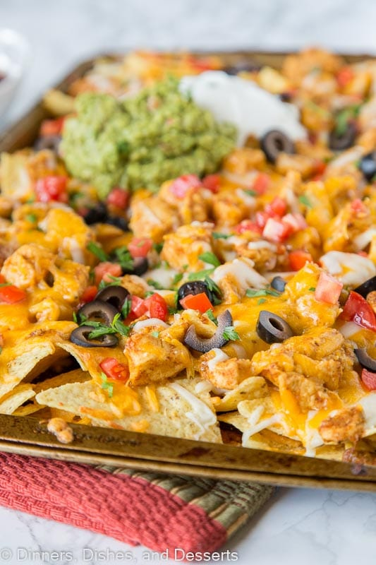 Sheet Pan Chicken Nachos - make a full tray of nachos for the whole family in minutes. Customize it to what your family likes, and get a dinner on the table, your family will love super fast!