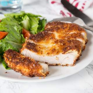 Crispy Pork Cutlet - tender boneless pork chops breaded and pan fried to crispy perfection. Served with a salad for a delicious meal any night of the week.
