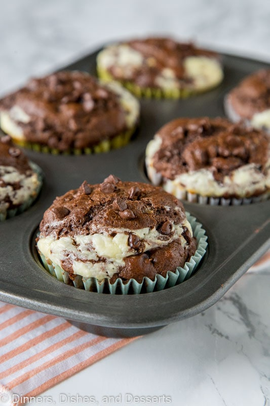 Double Chocolate Cheesecake Muffins - Rich, chocolate muffins with a layer of sweetened cream cheese for a light and tender breakfast or even dessert.
