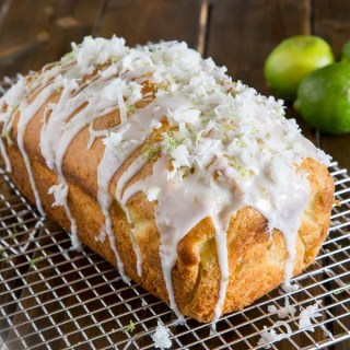 Coconut Lime Quick Bread - soft and tender coconut bread with hints of lime, topped with a lime glaze and flakes of sweetened coconut.