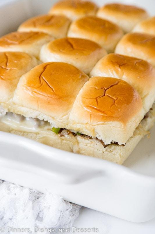 philly cheesesteak sliders in baking dish
