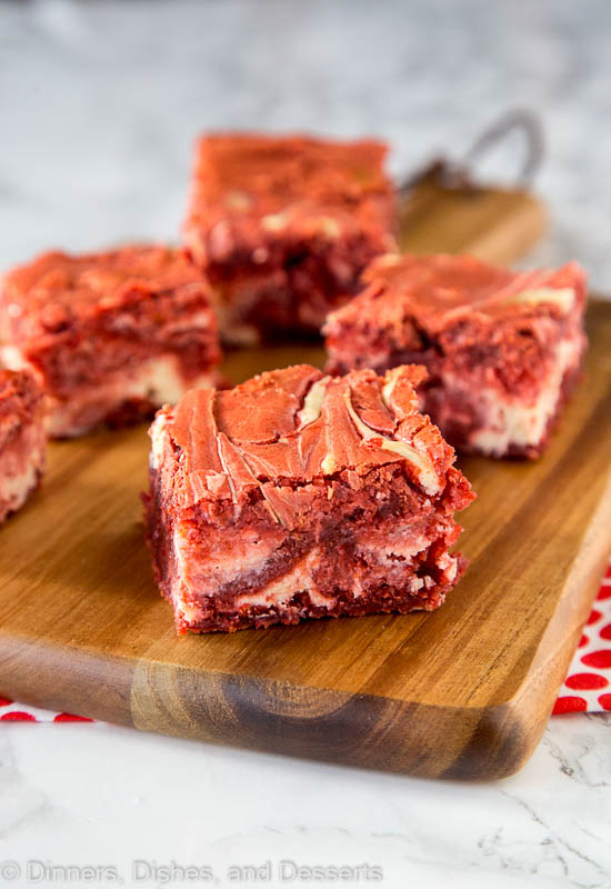 Red Velvet Brownies - thick and fudgy homemade brownies in a deep dark red color, swirled with cream cheese throughout. Red Velvet Cream Cheese Swirl Brownies look just as good as they taste!
