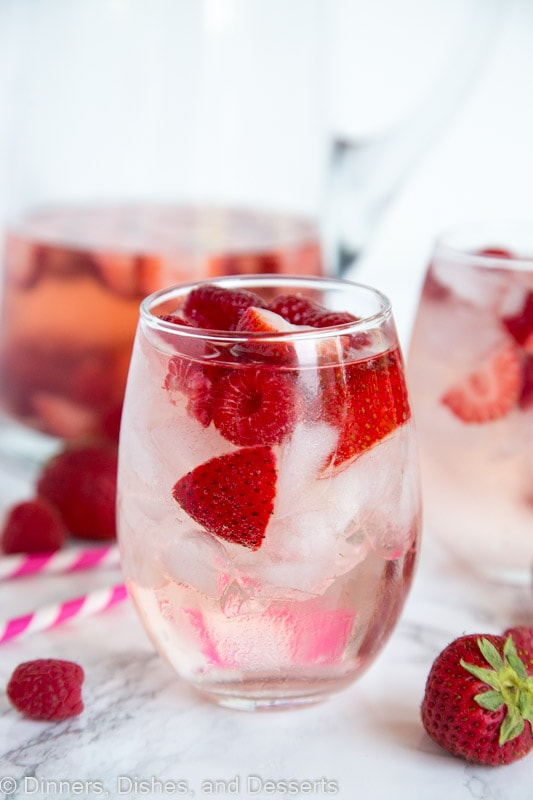 A close up of a glass cup on a table, with Sangria and Wine