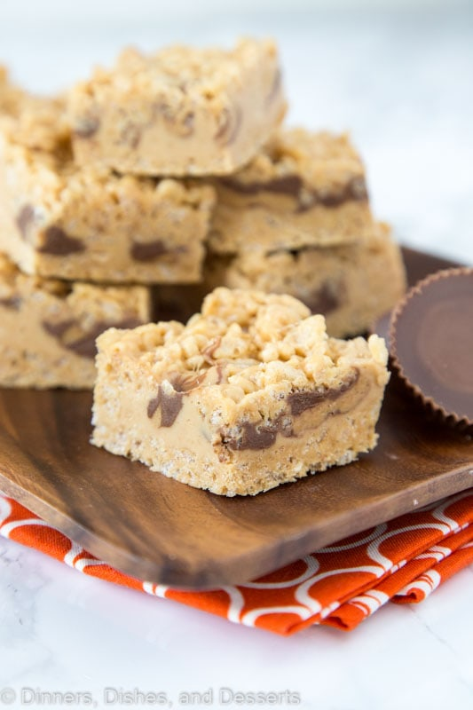 krispie treats with peanut butter and peanut butter cups on a tray