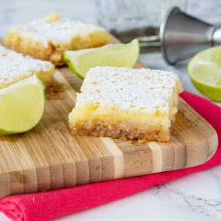 Margarita Bars Recipe - If you like classic lemon bars, you are going to love this lime bars spiked with tequila!  Everyone's favorite cocktail turned in to a creamy and delicious dessert!