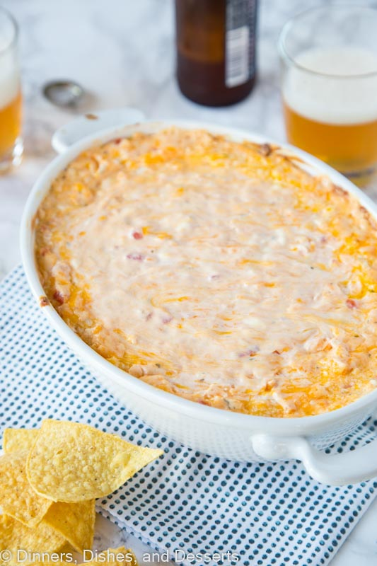 Baked Mexican Cheese Dip - Creamy, spicy, and super cheesy! The perfect dip for game day, get togethers or just because!