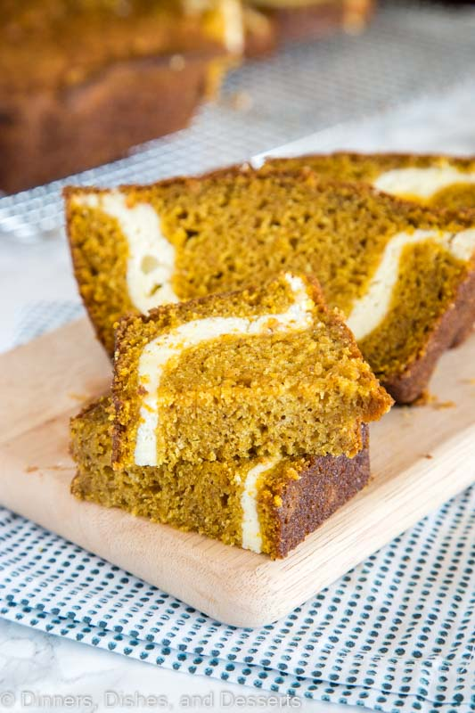 Pumpkin Cream Cheese Bread - a light and tender pumpkin bread, full of all the delicious spices with a layer of sweetened cream cheese swirled throughout.