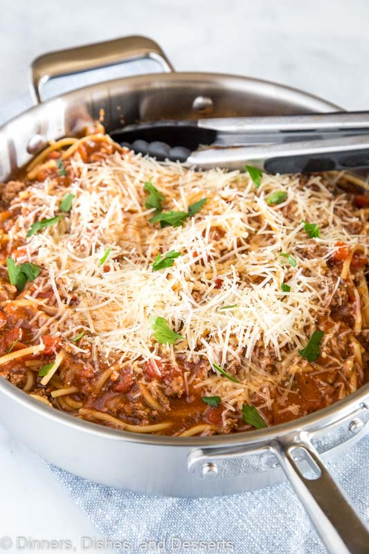pan of spaghetti topped with cheese