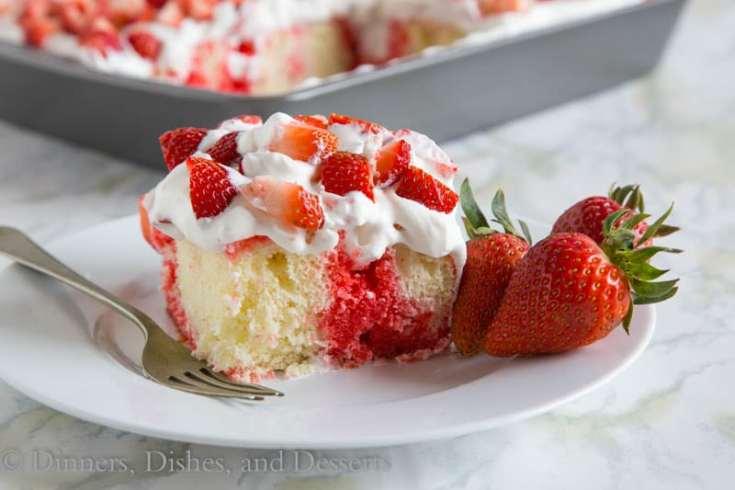 Strawberry Poke Cake - a classic poke cake with white cake, strawberry jello, whipped cream and lots of fresh strawberries!