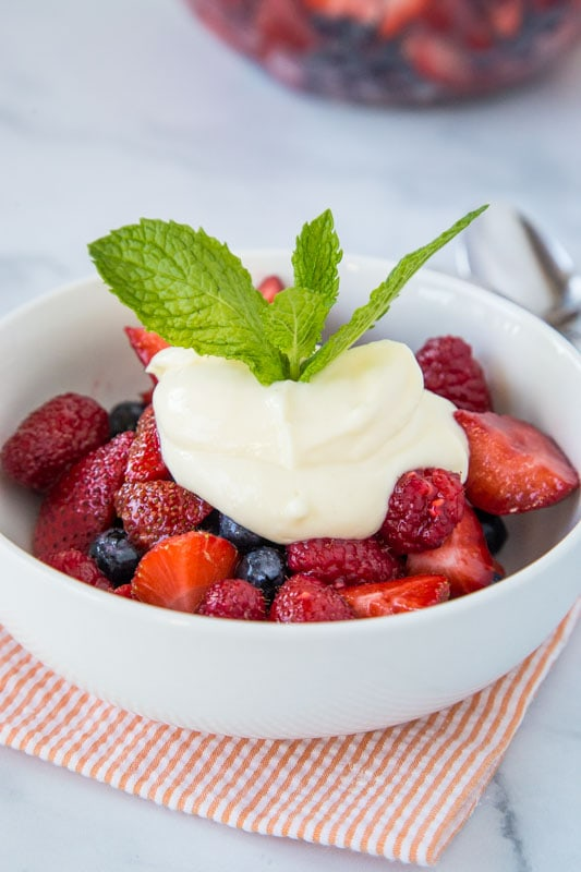 Easy fruit salad recipe with fresh strawberries, blueberries and raspberries. Topped with a lemon yogurt.