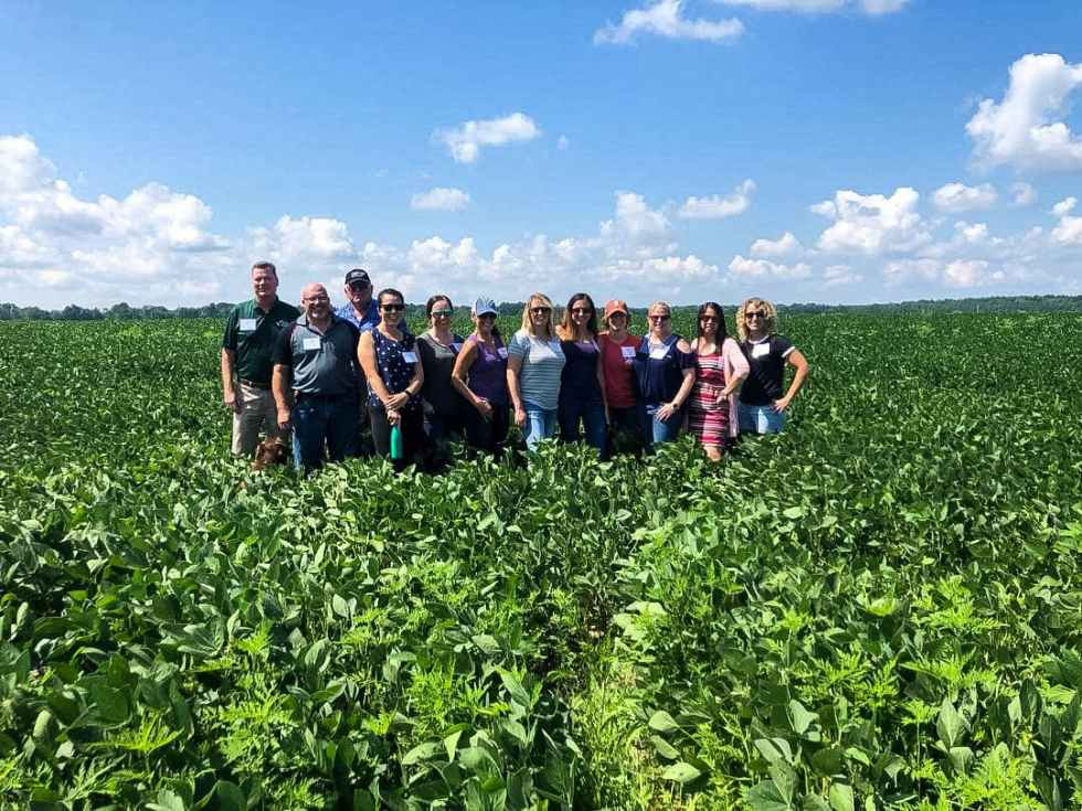In the field learning all about how soy beans are grown and sustainable farming.